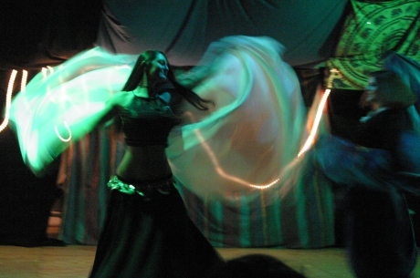 Belly dancing magic in 2002. She looks like she has wings. Maybe, now she does.