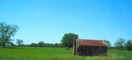 Fields and old houses of a different nature.