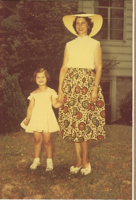 Me with Mom 1950. She wore this skirt to the store so I could find her. I was always getting lost looking at all the pretty colors on the labels and boxes.